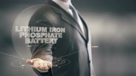 Lithium Iron Phosphate Battery with hologram businessman concept Stock Footage
