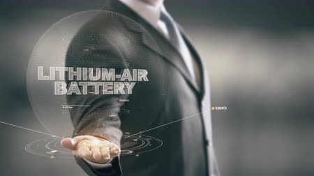 Lithium-Air Battery with hologram businessman concept