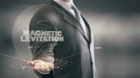 Magnetic Levitation with hologram businessman concept