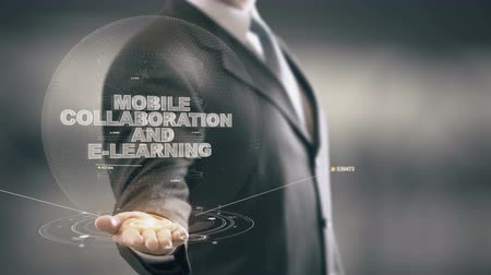 Mobile Collaboration And E-learning with hologram businessman concept
