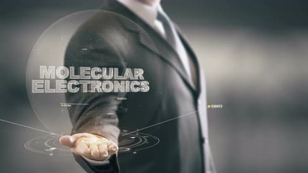 Molecular Electronics with hologram businessman concept