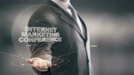 Internet Marketing Conference with hologram businessman concept