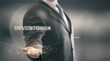 Investomer with hologram businessman concept