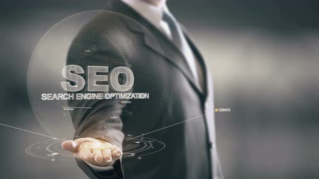 SEO – Search Engine Optimization with hologram businessman concept