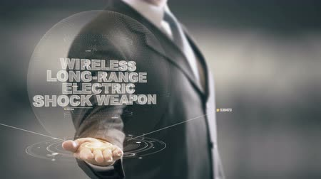 оборонительный : Wireless Long-Range Electric Shock Weapon with hologram businessman concept