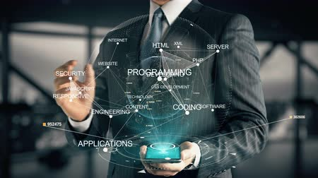 engineering : Businessman with CSS Development hologram concept Stock Footage