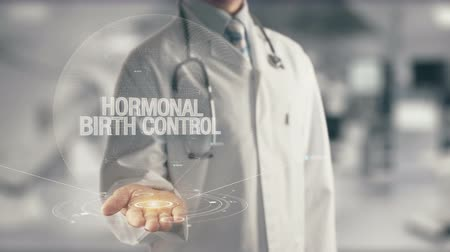 the conception : Doctor holding in hand Hormonal Birth Control