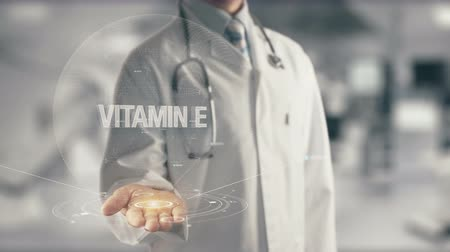 vitamin : Doctor holding in hand Vitamin E Stock mozgókép