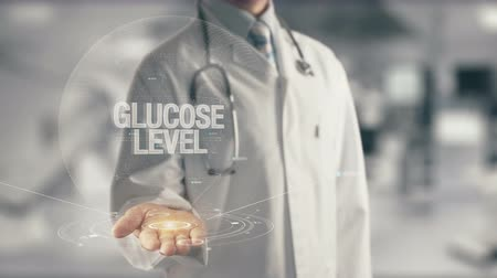 diyabet : Doctor holding in hand Glucose Level Stok Video