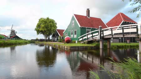 tükrözött : Cheese factory building at Zaanse Schans reflected on the calm canal water, in Zaandam, Netherlands