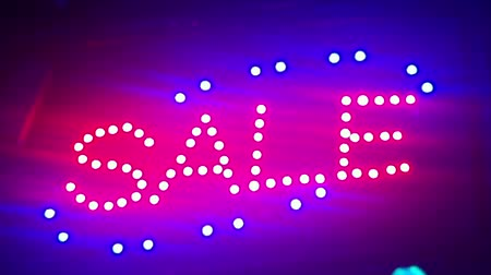 Illumination Sale. Street sign with small lights, garlands. Scenery with glowing, flashing lights. Dynamic, motion footage. Holiday movie. Stock mozgókép