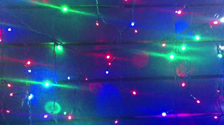 Illumination. Christmas tree garlands. Scenery with glowing, flashing lights. Dynamic, motion footage. Holiday movie.