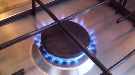 Kitchen stove. The gas is on, the burner is on with the sound of burning. Close-up video, real life