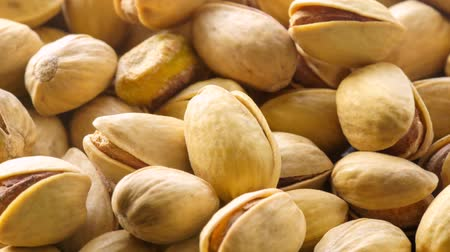 Pistachios. Nuts close-up video in high quality Slow motion camera