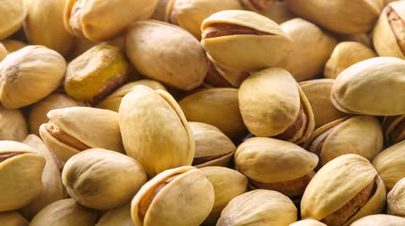 nasiona : Pistachios. Nuts close-up video in high quality Slow motion camera