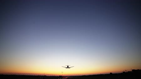 Airplane landing at dusk. Dynamic close up shot filmed in Full HD 1080p. Wide angle