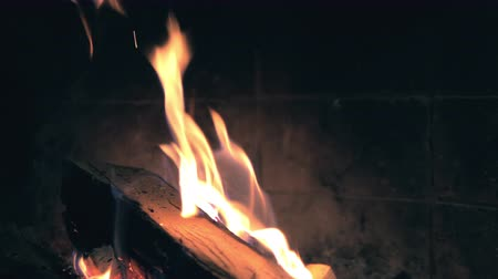 Burning wood in the fireplace. Slow motion 4k