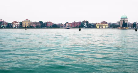 строгий : View from a cruise ship on the coastline with beautiful building in the Mediterranean city Venice, Italy in cloudy day. Dynamic shot filmed in 4k 2160p