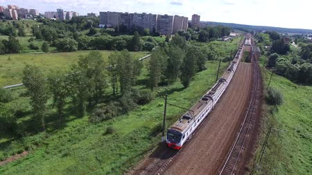 Electric train traveling by rail. Videography with copter.