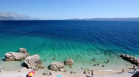 Средиземное море : Beautiful Beach and Adriatic Sea with Transparent Blue Water near Split, Croatia