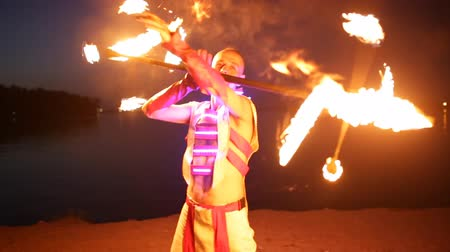 karnaval : Fireshow performance with burning torch at night outdoor Stok Video