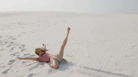 hiphop : Young woman dancing hip-hop on sand at desert in summer day