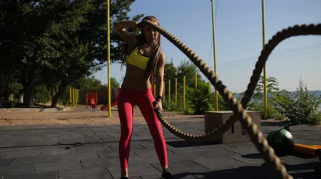 corda : Sportswoman workout outdoor. Cross-training exercise with rope. Stock Footage