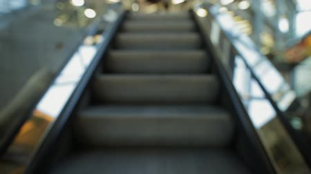 alışveriş : POV - I go on escalator in mall, blurred focus