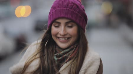 tongue out : Smiling woman showing tongue in a winter city Stock Footage