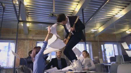 throwing in : Happy successful business people in office having fun throwing documents Stock Footage