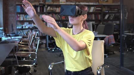 fejhallgató : Woman in VR glasses looking up and touch objects