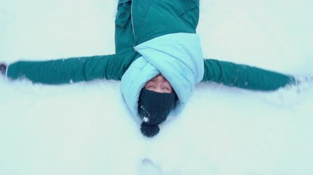 hanedan arması : Slow Motion Young woman making snow angels