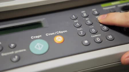 кнопка : Human Caucasian hand pushing buttons on fax machine