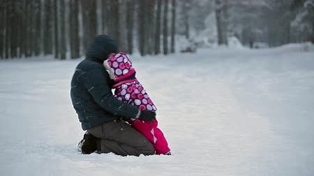 ceket : Young father with small baby playing in snowy field, Russian people, Russia