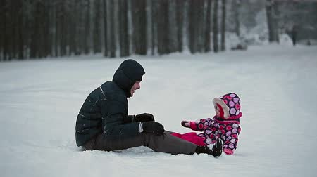 ruský : Young parent with small baby playing in snowy field, Russian people, Russia Dostupné videozáznamy