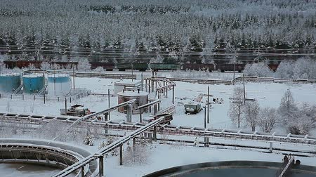water conservation : Freight carriages passing near water treatment plant in winter forest
