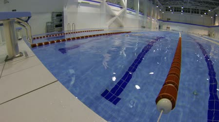 sportsmen : Young man in swimming pool on training