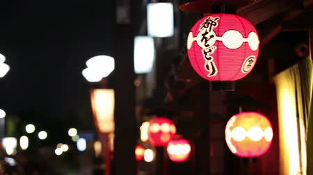 japan : TOKYO, JAPAN, CIRCA APRIL, 2013: GION, KYOTO, JAPAN, CIRCA APRIL, 2013: Gion is an oldest district of city with red lighting paper lanterns on house facades  Stock Footage