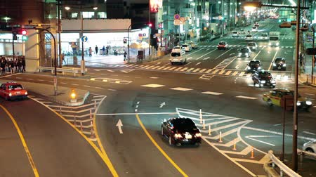 citiy : TOKYO, JAPAN - CIRCA APRIL: Night intersection of city roads with rear cars, Tokyo city, Japan Stock Footage