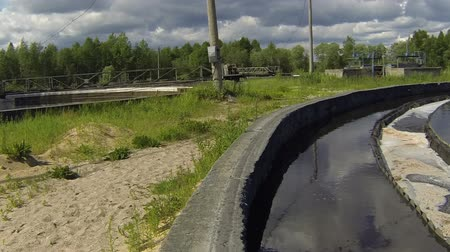 water conservation : Time lapse of water treatment plant unit moving with camera on a board around sewage pond in industrial plant Stock Footage