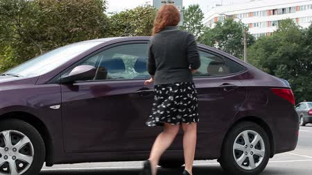 new car : Caucasian beautiful woman in high heels sitting in new car