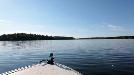 prędkość : View from bow of motorboat floating on water surface on lake