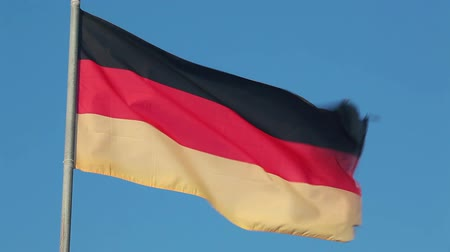 almanca : Germany national flag waving on flagpole on blue sky background
