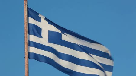 avrupa birliği : Greece national flag waving on flagpole on blue sky background