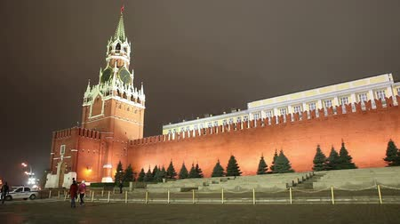greatest : View of Kremlin wall with Spasskaya tower on Red Square at night in Moscow, Russia Stock Footage