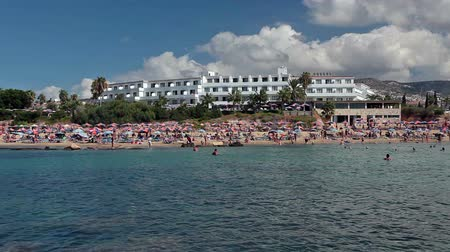 estância turística : Zoom out of Coral Bay beach from the sea. People sunbathing on sand, Peyia, Paphos, Cyprus Stock Footage