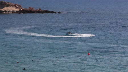 pwc : Riding in jet ski in Mediterranean sea in Coral Bay resort, Paphos, Cyprus