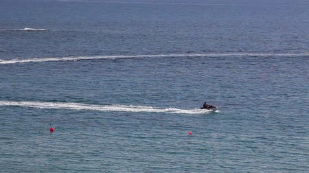 pwc : Riding on aquabike in Mediterranean sea in Coral Bay resort, Paphos, Cyprus Stock Footage