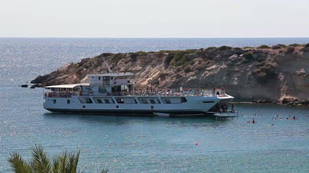 ciprus : Recreation ship in lagoon of Coal Bay with swimming peopel in Paphos, Cyprus