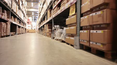 распределение : Moving camera along warehouse shelves with goods and materials